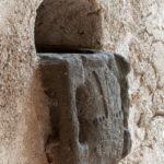 Acquasantiera all'ingresso del campanile